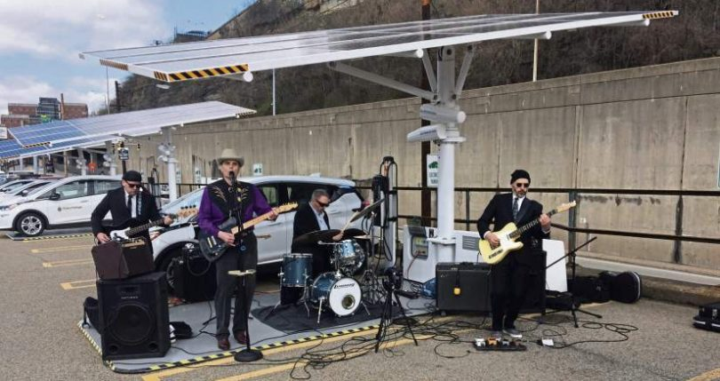 Band plays at press conference for solar charging stations